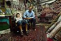 Iraq 2011  In the souk of Erbil, the shop of a rug salesman with a young boy <br />Irak 2011 Dans la boutique d'un marchand de tapis, souk d'Erbil