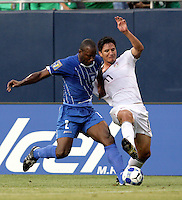 Osman Chavez (2) attempts to take the ball away from Brian Ching (11).  The US Men's National Team defeated Honduras 2-0 in the semifinals of the Gold Cup at Soldier Field in Chicago, IL on July 23, 2009.