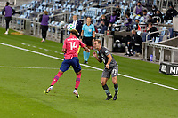 ST PAUL, MN - SEPTEMBER 9: Bryan Reynolds #14 of FC Dallas heads the ball away from Chase Gasper #77 of Minnesota United FC during a game between FC Dallas and Minnesota United FC at Allianz Field on September 9, 2020 in St Paul, Minnesota.