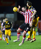 Lincoln City's Matt Rhead battles with  Newport County's Mark O'Brien<br /> <br /> Photographer Andrew Vaughan/CameraSport<br /> <br /> The EFL Sky Bet League Two - Lincoln City v Newport County - Saturday 22nd December 201 - Sincil Bank - Lincoln<br /> <br /> World Copyright © 2018 CameraSport. All rights reserved. 43 Linden Ave. Countesthorpe. Leicester. England. LE8 5PG - Tel: +44 (0) 116 277 4147 - admin@camerasport.com - www.camerasport.com