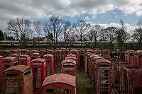 UK. Redhill. 20th March 2018<br /> Disused phone booths at Unicorn Restorations in Redhill, Surrey.<br /> Andrew Testa for the New York Times