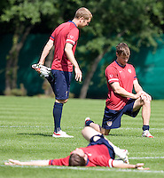 USA's Gregg Berhalter, Brian McBride and John O'Brien stretch before practice in Hamburg, Germany, for the 2006 World Cup, June, 9, 2006.