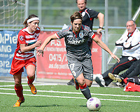 20140419 - ANTWERPEN , BELGIUM : Standard's Maud Coutereels (right) pictured with Antwerp Stephanie Suenens (left)  during the soccer match between the women teams of RAFC Antwerp Ladies  and Standard Femina  , on the 24th matchday of the BeNeleague competition on Saturday 19 April 2014 in Deurne .  PHOTO DAVID CATRY