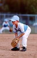 Young pitcher at a little league ballgame in Colorado in the summer. Model released