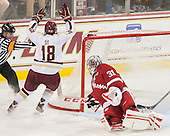 Jeff Bunyon, Michael Sit (BC - 18), Adam Miller (Wisconsin - 31) - The Boston College Eagles defeated the visiting University of Wisconsin Badgers 9-2 on Friday, October 18, 2013, at Kelley Rink in Conte Forum in Chestnut Hill, Massachusetts.
