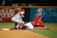 Syracuse Chiefs second baseman Bengie Gonzalez (3) attempts to tag Reese McGuire (3) safely stealing second base during a game against the Buffalo Bisons on July 6, 2018 at Coca-Cola Field in Buffalo, New York.  Buffalo defeated Syracuse 6-4.  (Mike Janes/Four Seam Images)