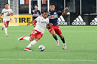 FOXBOROUGH, MA - JUNE 26: Collin Smith #32 of North Texas SC and Damian Rivera #72 of the New England Revolution battle for the ball during a game between North Texas SC and New England Revolution II at Gillette Stadium on June 26, 2021 in Foxborough, Massachusetts.