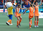 The Hague, Netherlands, June 14: Players of The Netherlands celebrates after winning the World Cup Trophy before the prize giving ceremony on June 14, 2014 during the World Cup 2014 at Kyocera Stadium in The Hague, Netherlands.  (Photo by Dirk Markgraf / www.265-images.com) *** Local caption *** Kim Lammers #23 of The Netherlands, Maartje Paumen #17 of The Netherlands, Naomi van As #18 of The Netherlands