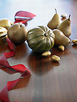 Fruits, squash, and nuts painted gold to be used as holiday decorations.