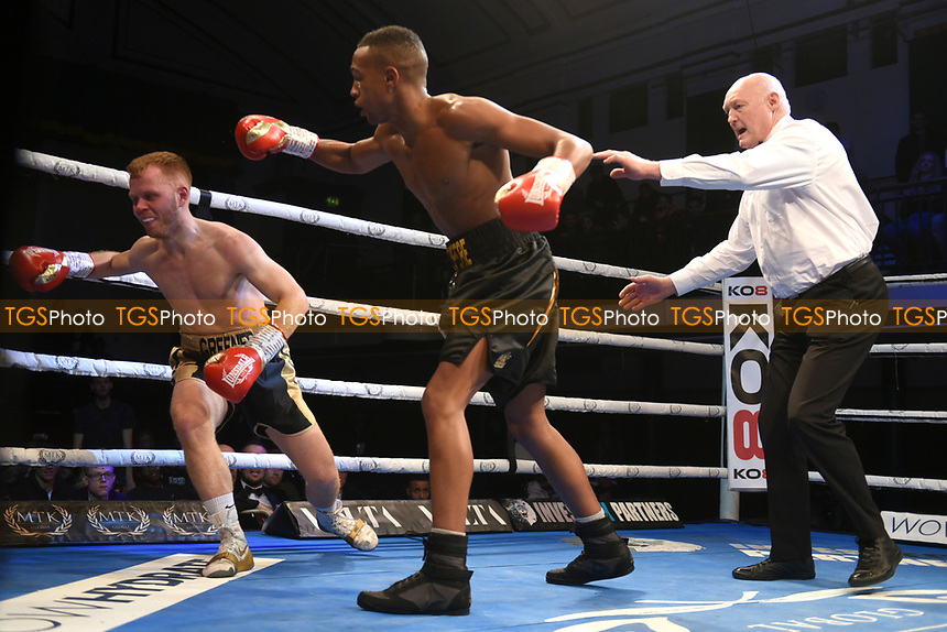 Aaron Prospere (black shorts) defeats Stuart Greener during a Boxing Show at York Hall on 9th November 2019