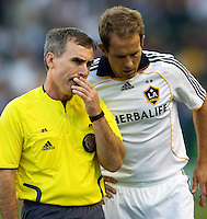 LA Galaxy midfielder Eddie Lewis and referee Michael Kennedy have a discussion. LA Galaxy defeated the Colorado Rapids 3-2 at Home Depot Center stadium in Carson, California on Sunday October 12, 2008. Photo by Michael Janosz/isiphotos.com