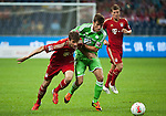 GUANGZHOU, GUANGDONG - JULY 26:  Thomas Muller (L) of Bayern Munich in action during a friendly match against VfL Wolfsburg as part of the Audi Football Summit 2012 on July 26, 2012 at the Guangdong Olympic Sports Center in Guangzhou, China. Photo by Victor Fraile / The Power of Sport Images