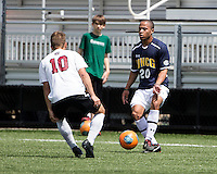 The UNC Greensboro Spartans played the University of South Carolina Gamecocks in The Manchester Cup on April 5, 2014.  The teams played to a 0-0 tie.  Justin Jones (20), Devin L'Amoreaux (10)
