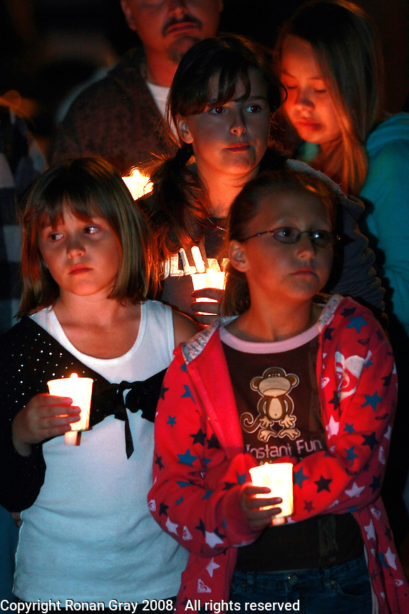 San Diego, CA, Friday, March 28 2008:  Neighbors, relatives, friends, teachers and students gather at Barnard Elementary School in Point Loma for a candlelight vigil for Rosa Lisowski who has been missing since Monday.  Lisowski was last seen dropping her son off at the school on Monday morning.