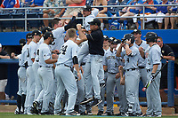Wake Forest Demon Deacons head coach Tom Walter (16) leaps into a group of his players prior to the game against the Florida Gators in Game One of the Gainesville Super Regional of the 2017 College World Series at Alfred McKethan Stadium at Perry Field on June 10, 2017 in Gainesville, Florida. The Gators defeated the Demon Deacons 2-1 in 11 innings. (Brian Westerholt/Four Seam Images)