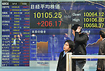 March 14, 2012, Tokyo, Japan - The electric board of a local stock brokerage in Tokyo flashes the share quotes Wednesday morning, March 14, 2012. Tokyo stocks closed the morning session sharply higher with the Nikkei Stock Average hitting its highest level in seven and a half months as the weaker yen pushed up exporters. The benchmark index ended morning trade at 10,099.97, up 200.89 points, or 2.03%. (Photo by Natsuki Sakai/AFLO) AYF -mis-