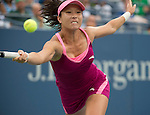 Jie Zheng (CHN) battles against Venus Williams (USA) at the US Open being played at USTA Billie Jean King National Tennis Center in Flushing, NY on August 28, 2013
