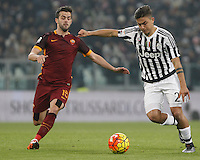 Juventus' Paulo Dybala, right, is challenged by Roma's Miralem Pjanic during the Italian Serie A football match between Juventus and Roma at Juventus Stadium.