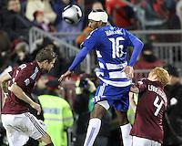 Atiba Harris#16 of FC Dallas heads between Drew Moor#3 and Jeff Larentowicz#4 of the Colorado Rapids during MLS Cup 2010 at BMO Stadium in Toronto, Ontario on November 21 2010. Colorado won 2-1 in overtime.