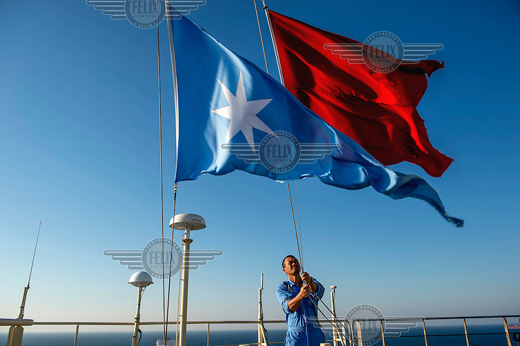 Flags are raised as the Mary Maersk, the largest container ship in the world, enters a port.