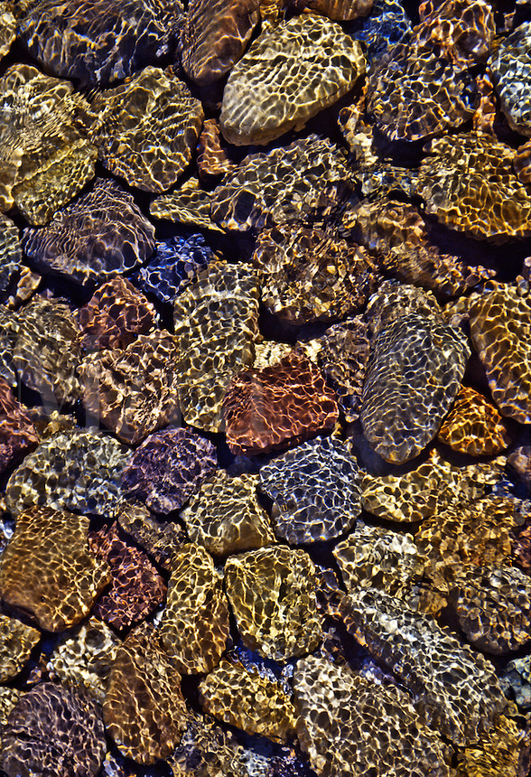 Rocks in shallow water with refracted light