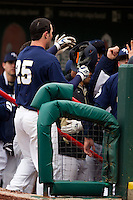 Brandon King (25) of the Oral Roberts Golden Eagles is congragulated by teammates in the dugout after hitting a home run during a game against the Missouri State Bears on March 27, 2011 at Hammons Field in Springfield, Missouri.  Photo By David Welker/Four Seam Images