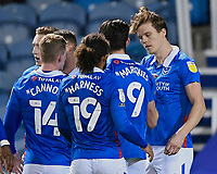 Sean Raggett of Portsmouth (20)  right is congratulated on scoring the first goal during Portsmouth vs Oxford United, Sky Bet EFL League 1 Football at Fratton Park on 24th November 2020