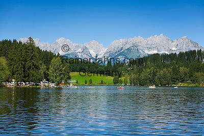 Austria, Tyrol, near Kitzbuhel: idyllic Schwarzsee (Black Lake) on the outskirts of Kitzbuhel, at background Wilder Kaiser mountains   Oesterreich, Tirol, bei Kitzbuehel: Schwarzsee, idyllisch gelegener Badesee, 8 ha gross und bis zu 8 m tief, einer der waermsten Seen der Alpen, im Hintergrund das Wilder Kaiser Gebirge