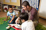 Education Preschool Headstart 3-4 year olds young male teacher reading to children