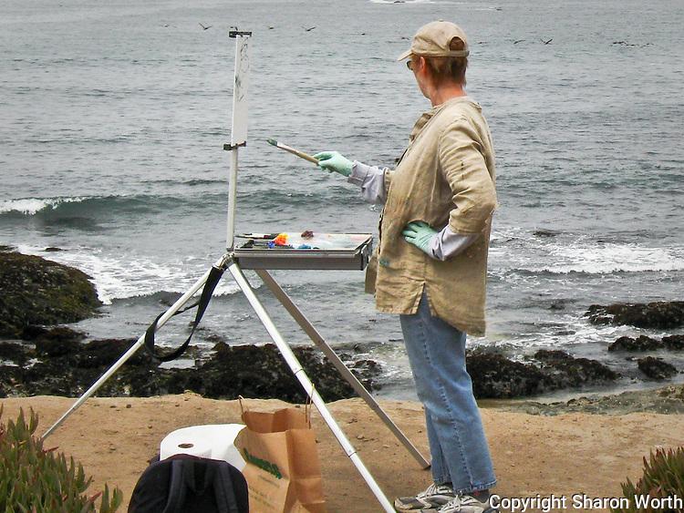 Artist Joyce Converse (joyceconversepaintings.com) at her easel on the central California coast