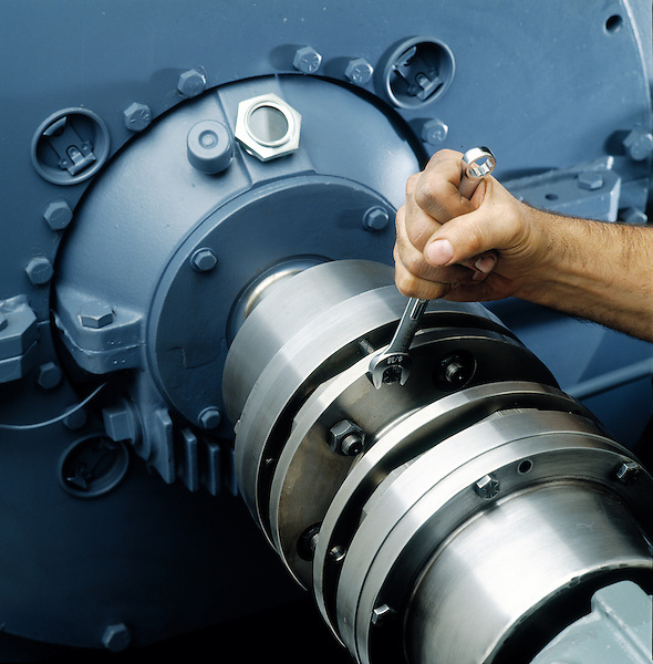 Hand tightening bolts on turbine installation