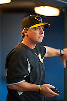 West Virginia Black Bears pitching coach Mark DiFelice in the dugout during a game against the Batavia Muckdogs on June 28, 2016 at Dwyer Stadium in Batavia, New York.  Batavia defeated West Virginia 3-1.  (Mike Janes/Four Seam Images)