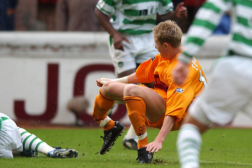 7TH MAY 2003, MOTHERWELL V CELTIC, FIR PARK, MOTHERWELL, DAVID COWAN OF MOTHERWELL SUFFERS A DOUBLE LEG BREAK AFTER TACKLE BY CELTIC'S PAUL LAMBERT, ROB CASEY PHOTOGRAPHY.
