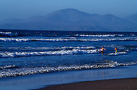 Children play in the surf in La Serena which enjoys a transitional climate between the arid northern desert of the Atacama and the pleasant Mediterranean climate of the central coast. Chile's premier beach north of Santiago has pristine white sand beaches that is rain free nine months a year.