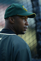 Jermaine Dye of the Oakland Athletics during a 2003 season MLB game at Angel Stadium in Anaheim, California. (Larry Goren/Four Seam Images)