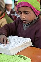 Madrasa Student Reading the Koran, Madrasa Imdadul Uloom, Dehradun, India.