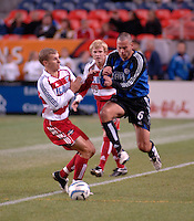 Colorado defender Mike Petke pushes the ball past FC Dallas midfielder Ronnie O'Brien. The Colorado Rapids drew 0-0 with FC Dallas in the first game of the Western Conference Semi-finals Invesco Field at Mile High, Denver, Colorado, September 22, 2005.