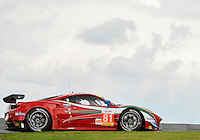 Stephen Wyatt / Michele Rugolo / Andrea Bertolini of AF Corse driving (81) LMGTE Am Ferrari F458 Italia during FIA World Endurance Challenge free practice #1, Thursday, September 18, 2014 in Austin, Tex. (Mo Khursheed/TFV Media via AP Images)