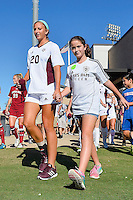 Texas A&M defender/midfielder McKayla Paulson (20) enters the field accompanied by a fan before NCAA soccer game, Sunday, October 26, 2014 in College Station, Tex. South Carolina draw 2-2 against Texas A&M in double overtime. (Mo Khursheed/TFV Media via AP Images)