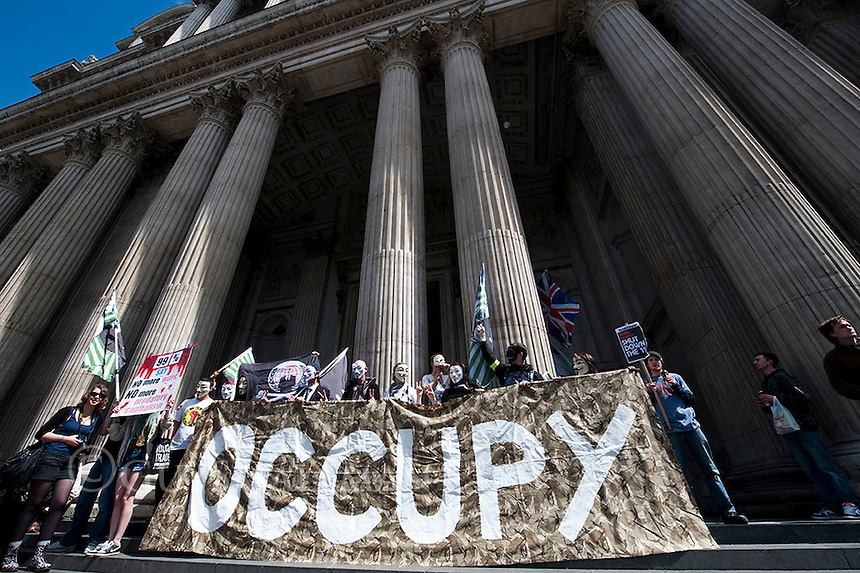Occupy worldwide day of action. London 12-5-12 Occupy protesters meet at St Pauls and then go around the City of London periodically scuffling with Police. They event ually set up a temporary camp at The Bank of England.