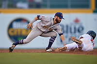 Burlington Bees shortstop Alvaro Rubalcaba (19) tags Gabriel Moreno (23) out at second base during a Midwest League game against the Lansing Lugnuts on July 18, 2019 at Cooley Law School Stadium in Lansing, Michigan.  Lansing defeated Burlington 5-4.  (Mike Janes/Four Seam Images)