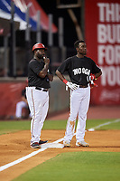 Chattanooga Lookouts second baseman Nick Gordon (1) talks with manager Tommy Watkins (8) while on third base during a game against the Jackson Generals on May 9, 2018 at AT&T Field in Chattanooga, Tennessee.  Chattanooga defeated Jackson 4-2.  (Mike Janes/Four Seam Images)