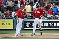Boston Red Sox coach Brian Butterfield (55) fist bumps catcher Matt Spring (81) during a Spring Training game against the New York Mets on March 16, 2015 at JetBlue Park at Fenway South in Fort Myers, Florida.  Boston defeated New York 4-3.  (Mike Janes/Four Seam Images)