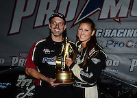 Sept. 16, 2012; Concord, NC, USA: NHRA pro mod driver Leah Pruett celebrates after winning the O'Reilly Auto Parts Nationals at zMax Dragway. Mandatory Credit: Mark J. Rebilas-