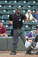 Home plate umpire Zach Tieche calls a batter out on strikes during the Carolina League game between the Potomac Nationals and the Winston-Salem Dash at BB&T Ballpark on July 15, 2016 in Winston-Salem, North Carolina.  The Dash defeated the Nationals 10-4.  (Brian Westerholt/Four Seam Images)