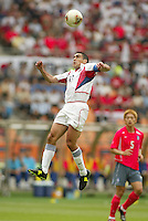 Claudio Reyna goes up for a header. The USA tied South Korea, 1-1, during the FIFA World Cup 2002 in Daegu, Korea.