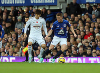Liverpool, UK. Saturday 01 November 2014<br /> Pictured L-R: Ki Sung Yueng of Swansea against James McCarthy of Everton. <br /> Re: Premier League Everton v Swansea City FC at Goodison Park, Liverpool, Merseyside, UK.