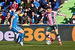 Mauro Arambarri of Getafe FC and Joaquin Sanchez of Real Betis Balompie during La Liga match between Getafe CF and Real Betis Balompie at Wanda Metropolitano Stadium in Madrid, Spain. January 26, 2020. (ALTERPHOTOS/A. Perez Meca)