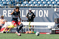 FOXBOROUGH, MA - JULY 25: USL League One (United Soccer League) match. Nicolas Firmino #29 of New England Revolution II clears the ball during a game between Union Omaha and New England Revolution II at Gillette Stadium on July 25, 2020 in Foxborough, Massachusetts.
