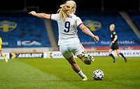 SOLNA, SWEDEN - APRIL 10: Lindsey Horan #9 of the United States crosses a ball during a game between Sweden and USWNT at Friends Arena on April 10, 2021 in Solna, Sweden.